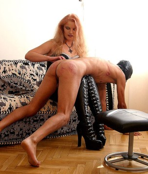 Sexy Redhead Mistress Bends Her slave Over and Humiliates him Hard