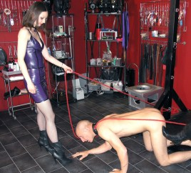 Two Sexy Dominas Discipline a naked slave and Get Their Boots Licked