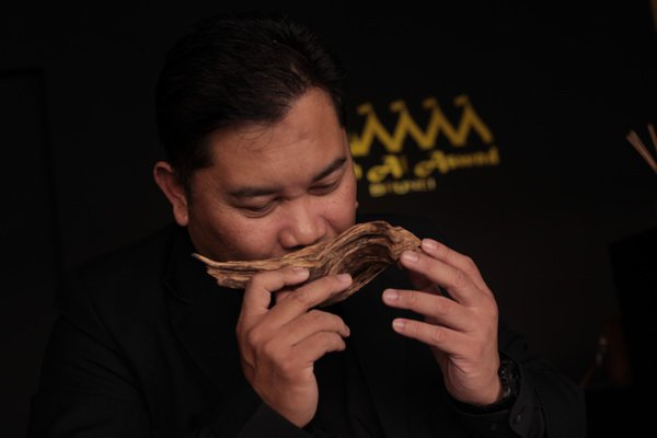 Hj Raduan taking a whiff off a bark of agarwood - said to be the most expensive timber in the world