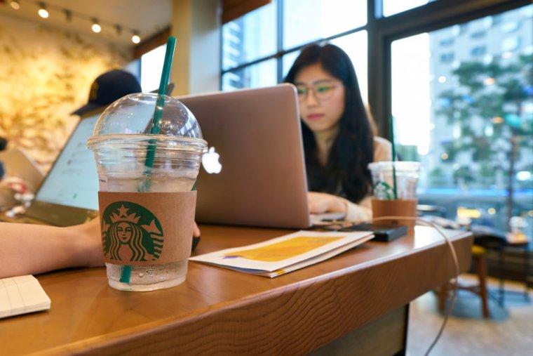 Freelancer using laptop at Starbucks
