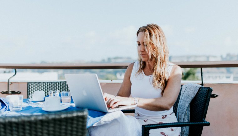 Digital nomad working using a laptop