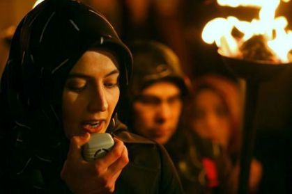 A protester from Mazlumder, a human-rights organization, speaks into a microphone in Istanbul, January 26, 2008, during a demonstration to protest against a ban on the wearing of the Islamic headscarf in universities and in certain public buildings. Turkish President Abdullah Gul said on Friday he backed the Islamist-rooted government's proposal to lift a ban on the wearing of the Islamic headscarf in universities, a move opposed by the secular establishment. REUTERS/Fatih Saribas (TURKEY)