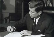John F. Kennedy Signing documents - BW