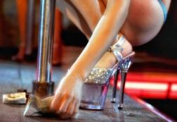 stripper picking up bills, photo