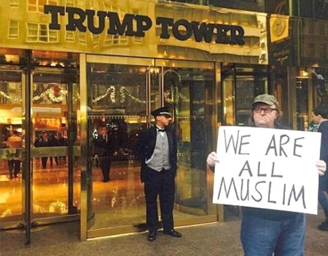 michael moore muslim sign trump protest