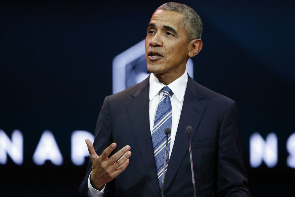 Obama talks at climate change summit as mayors sign charter