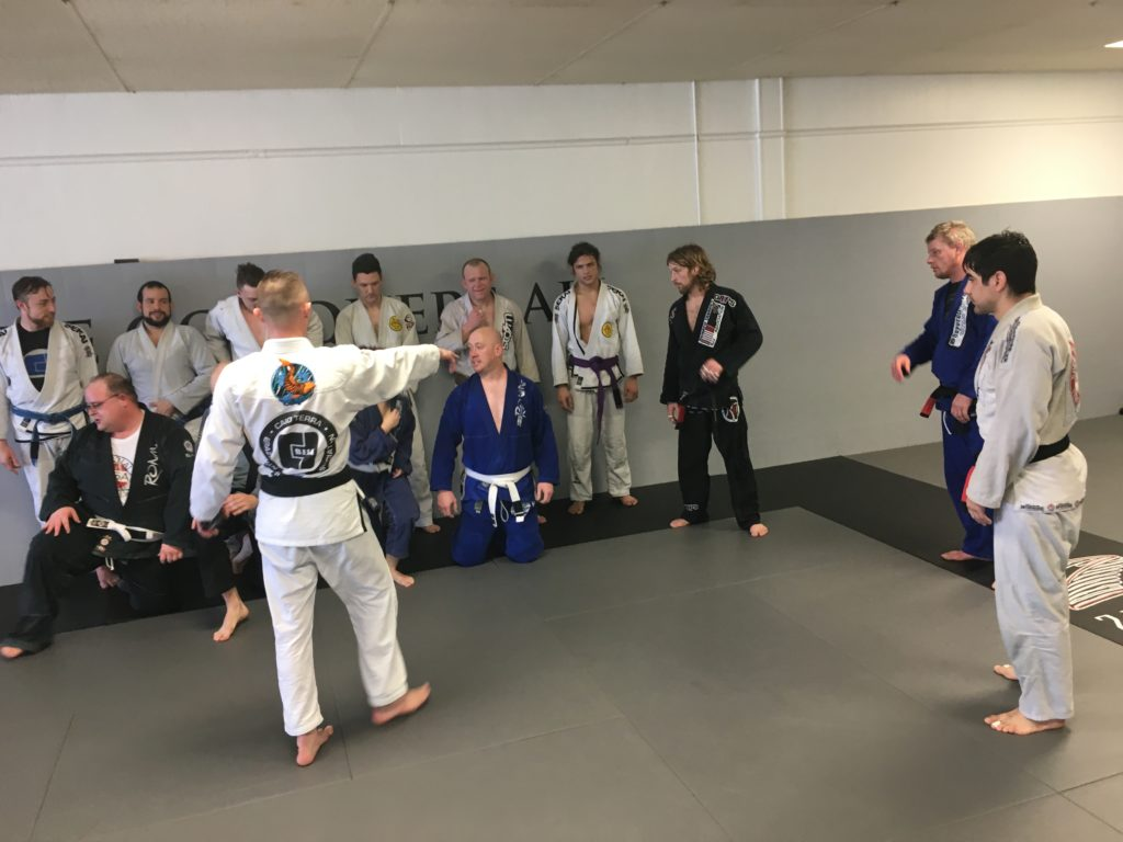 Setting up the BJJ Team Photo After Training at Midwest Pans Camp