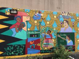 A student-painted mural nearby the new garden in the playground