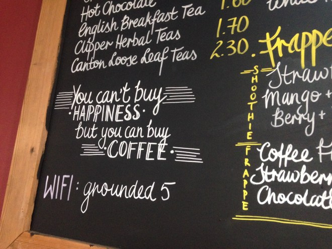 """On board """" You can't buy happiness, but you can buy Coffee"""""""