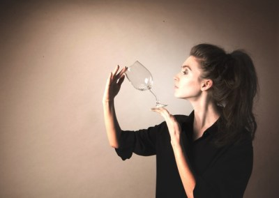 Jeanette Andrews Magician bending a glass