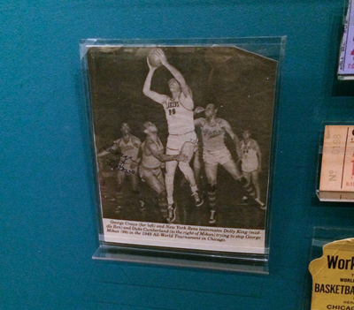 Newspaper article covering  the 1948 World Championship of Professional Basketball, with New York Rens player George Crowe's signature in ink on the image | 1948 | Newspaper clipping