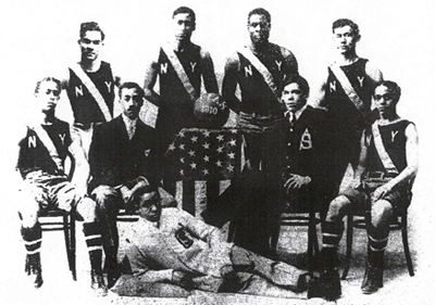 The New York All Stars, ca. 1910, with Major Aloysius Hart (seated, second from right) and future African American basketball promoter and team owner Will Anthony Madden (reclined), then the All Star's mascot. (The Black Fives Foundation)