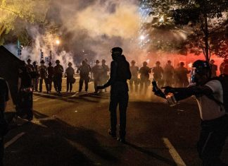 Demonstrators confronted police officers outside the White House on Saturday.Credit...Eric BaradatAgence France-Presse Getty Images