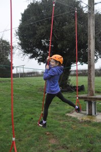 low level ropes course young girl ropes swing crossing