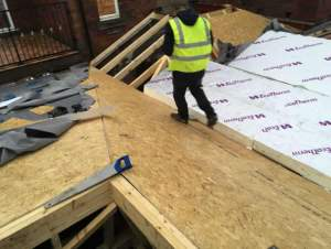 Warm roof build up during construction. GRP FIbreseal Roof by Blackpool Industrial Roofing.
