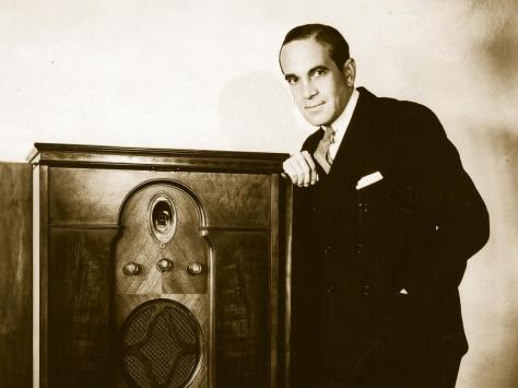 American singing entertainer Al Jolson leaning on a radiogram. Photo: Getty Images