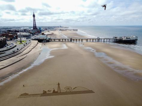 To mark the big day, a 70m etching of the town's skyline – including the Tower, Central Pier's big wheel, and the Big One – was raked into the sand on the beach