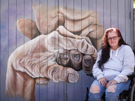 Kirsty Rea with her mural. Picture: Daniel Martino/JPI Media
