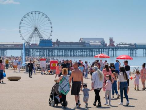 Sun lovers flock to the beach and promenade