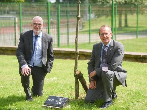 Peter Murphy and Jim Gardner from Blackpool Teaching Hospitals with the tree dedicated to the NHS.
