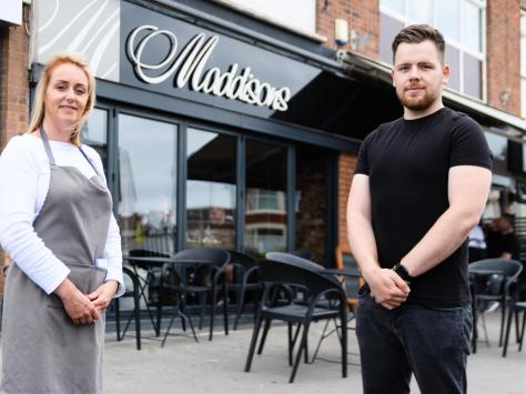 Cobi Barber, 22, pictured with mum Lisa who co-owns Maddisons cafe bar, saved a customer's life this week when he performed a Heimlich manoeuvre while she was choking. Picture: Kelvin Stuttard/JPI Media