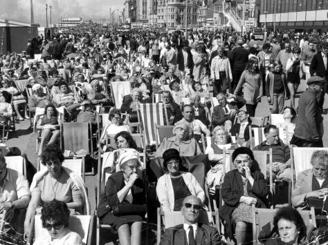 Every deckchair was taken in this classic picture of Blackpool promenade on a Whit Monday in the 1960s