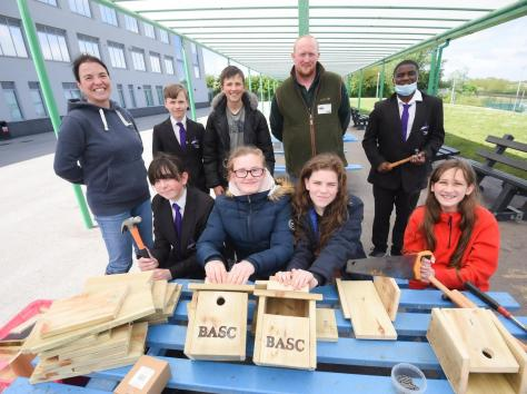 Teacher Peggy Plancke with Murray Woodward from BASC, helping year eight pupils from Aspire Academy to build bird boxes. Picture: Daniel Martino/JPI Media