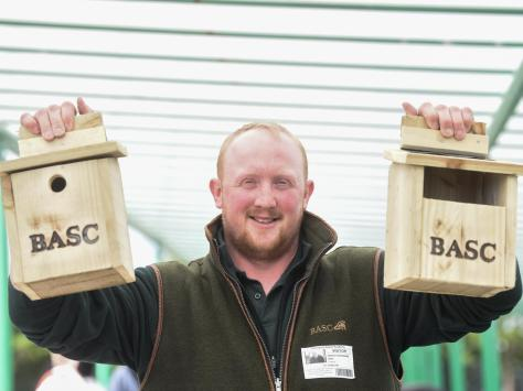 Murray Woodward from BASC helps pupils at Aspire Academy make bird boxes to encourage birds to visit the school grounds. Picture: Daniel Martino/JPI Media