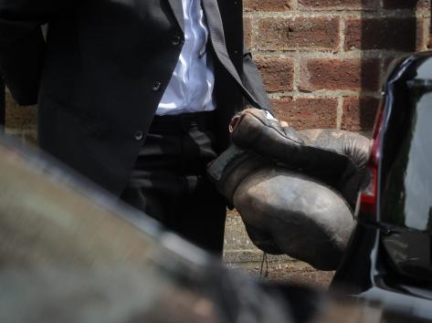 The boxing gloves that were placed on the coffin
