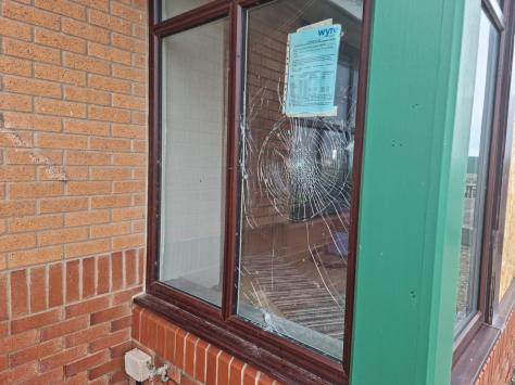 """One of the smashed windows, which could take """"up to six weeks"""" to replace. Pic: JPI Media"""