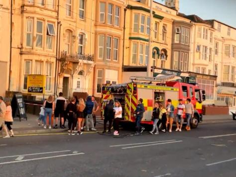 The incident drew a crowd of onlookers, with customers from The Manchester pub next door watching the event unfold. Pic: Mark Harper