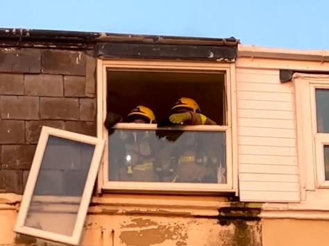 During the firefighting, crews punched out a window on the top floor to allow thick smoke to escape, sending a glass pane smashing to the pavement below. Pic: Mark Harper