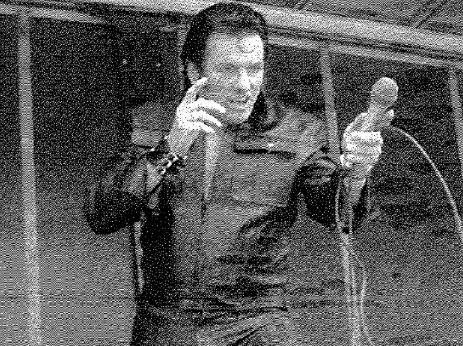 Joseph Thompson on stage as Elvis