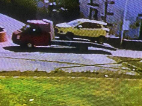 In the footage, two men - one driving the low-loader and another in a white Transit van - can be seen casually winching her yellow EcoSport onto the back of a recovery truck before driving away with it