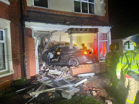 The BMW crashed into the house at around 1am on Monday