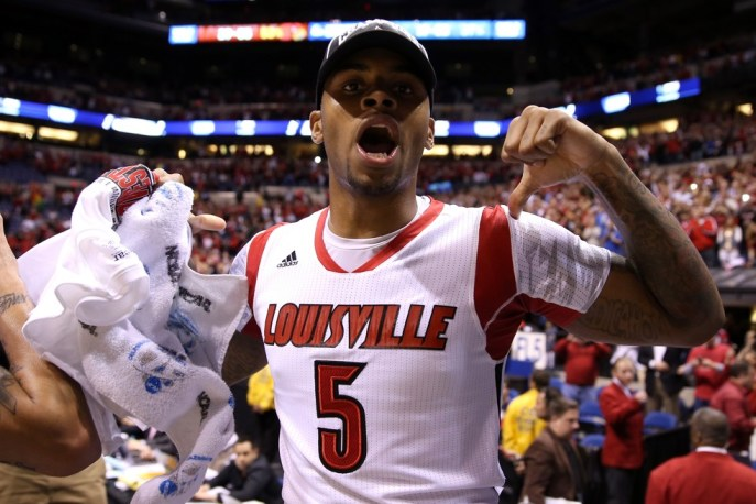 Chane Behanan celebrates Louisville's win — wearing Kevin Ware's jersey. (Andy Lyons / Getty Images)