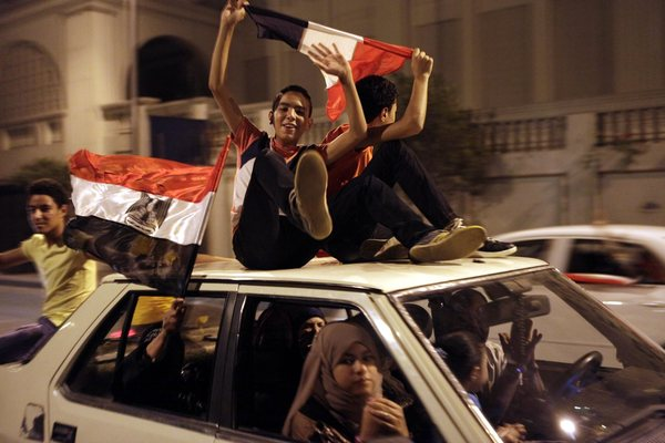Egyptians celebrate along the Nile in Cairo after the military announced the removal of President Mohamed Morsi. (Amel Pain / European Pressphoto Agency / July 3, 2013)