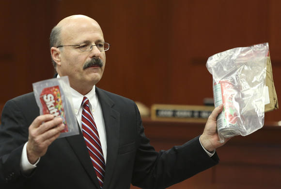 Assistant state attorney Bernie de la Rionda holds up evidence to the jury while presenting the state's closing arguments against George Zimmerman during his trial in Seminole circuit court in Sanford, Fla. Thursday, July 11, 2013. Zimmerman has been charged with second-degree murder for the 2012 shooting death of Trayvon Martin. (Gary W. Green/Orlando Sentinel) (Gary W. Green / Orlando Sentinel / July 10, 2013)