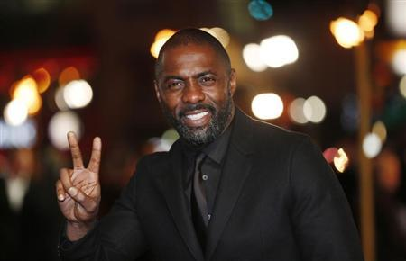 "Actor Idris Elba gestures as he arrives for the world premiere of ""Les Miserables"" in London December 5, 2012. REUTERS/Suzanne Plunkett"