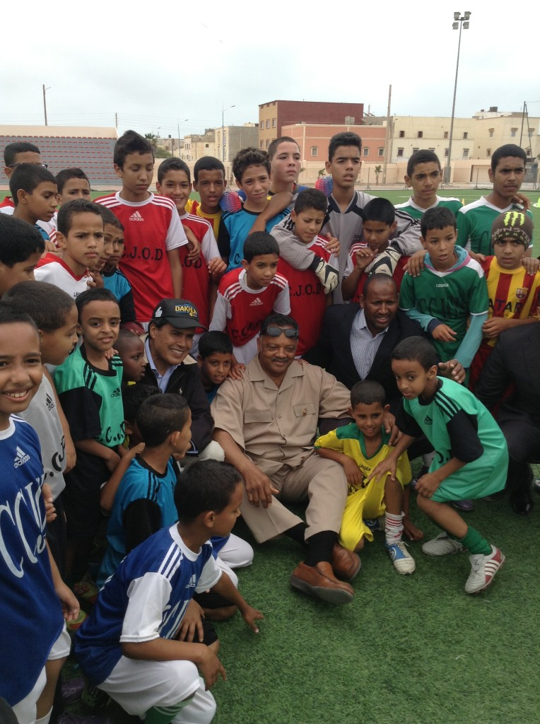 Jesse Jackson surrounded by soccer players in Dakhla, Morocco (NNPA Photo by George E. Curry).