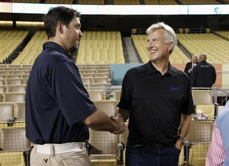 Walter shakes hands with Beckett during a news conference for newly acquired Los Angeles Dodgers' Punto Beckett and Gonzalez in Los Angeles