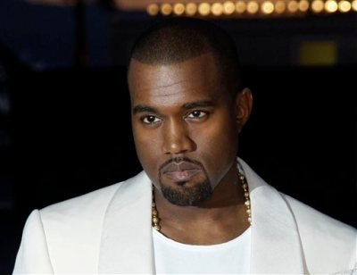 """In this May 23, 2012 file photo, singer Kanye West arrives for the screening of """"Cruel Summer"""" at the 65th international film festival, in Cannes, southern France.  West appeared on """"Jimmy Kimmel Live"""" Wednesday night Oct. 9, 2013 to discuss his feud with Kimmel. (AP Photo/Francois Mori, File)"""