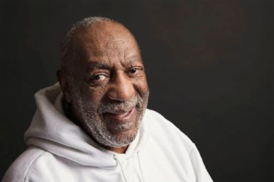 "This Nov. 18, 2013 photo shows actor-comedian Bill Cosby in New York. Cosby will star in a new comedy special ""Bill Cosby: Far from Finished,"" premiering Nov. 23, at 8 p.m. EST on Comedy Central. (Photo by Victoria Will/Invision/AP)"