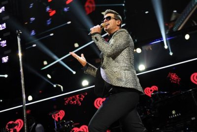 """This Dec. 13, 2013 file photo shows Robin Thicke performing at Z100's Jingle Ball 2013 at Madison Square Garden in New York. Marvin Gaye's children have dismissed their lawsuit against EMI after claiming the record label didn't pursue copyright infringement against Robin Thicke because """"Blurred Lines"""" has similarities to Gaye's """"Got to Give It Up."""" A Los Angeles judge Tuesday, Jan. 14, 2014, granted Nona Marvisa Gaye and Frankie Christian Gaye's dismissal against EMI, which is owned by Sony/ATV Music Publishing.  (Photo by Evan Agostini/Invision/AP, File)"""