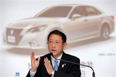 In this May 8, 2013 file photo, Toyota Motor Corp. President Akio Toyoda speaks during a news conference at the automaker's headquarters in Tokyo. (AP Photo/Itsuo Inouye, File)