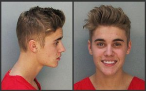 These police booking mugs made available by the Miami Dade County Corrections Department show pop star Justin Bieber, Thursday, Jan. 23, 2014. (AP Photo/Miami Dade County Jail)