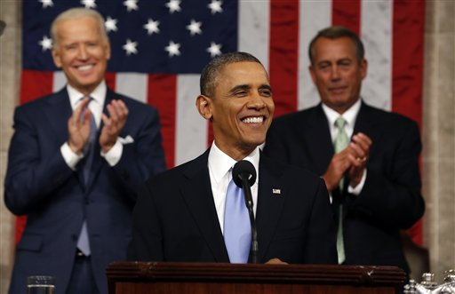 President Barack Obama delivers the State of Union address before a joint session of Congress in the House chamber Tuesday, Jan. 28, 2014, in Washington, as Vice President Joe Biden, and House Speaker John Boehner of Ohio, applaud. (AP Photo/Larry Downing, Pool)