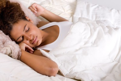 bigstockphoto_sleeping_african_lady_6380013