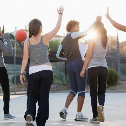 Young people playing basketball