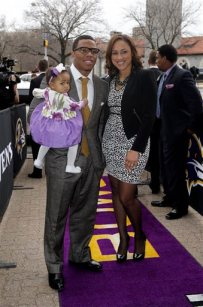 In this March 11, 2013 file photo, Baltimore Ravens running back Ray Rice, left, poses with his daughter, Rayven, and Janay Palmer as they arrive for a screening of a new film released on DVD that chronicles the team's championship NFL football season in Baltimore. (AP Photo/Patrick Semansky, File)